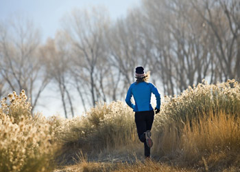 Jogging Woman running outside in nature on forest track