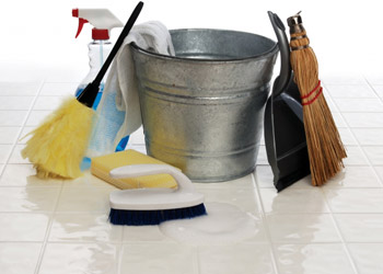 Silver bucket broom cleaning agent sponge shovel lying on the floor for cleaning