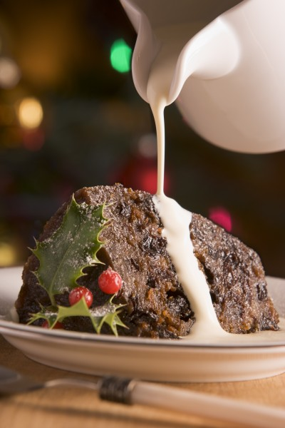portion of christmas pudding with pouring