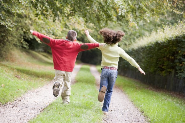 two young friends running on a