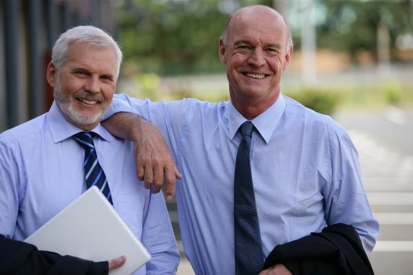 portrait of older men in suits