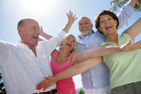 happy group of seniors by raising