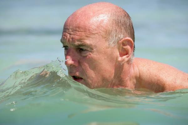 portrait of elderly man bathing in
