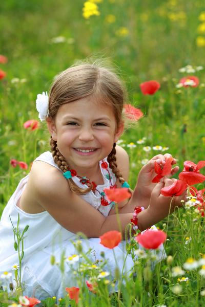 girl with wild poppy flowers