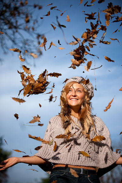 autumn woman with leaves falling