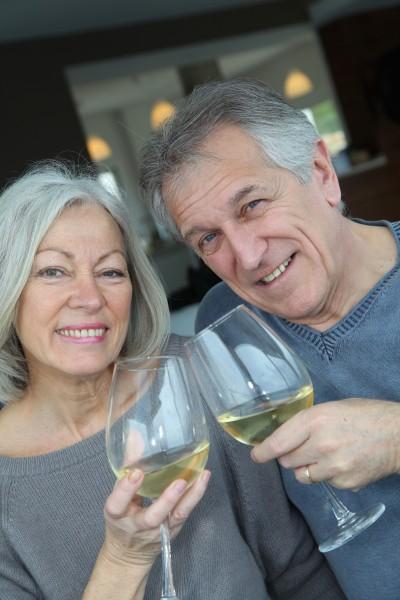 portrait of happy senior couple cheering