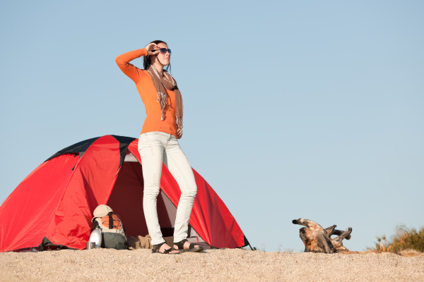 camping happy woman outside tent on