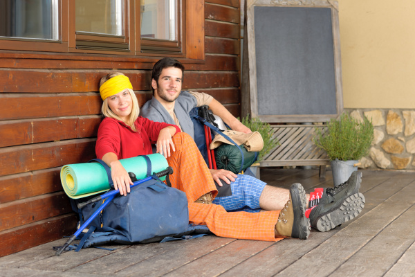 tramping young couple backpack relax by