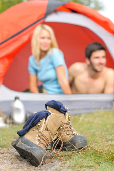 hiking boots outside tent camping couple