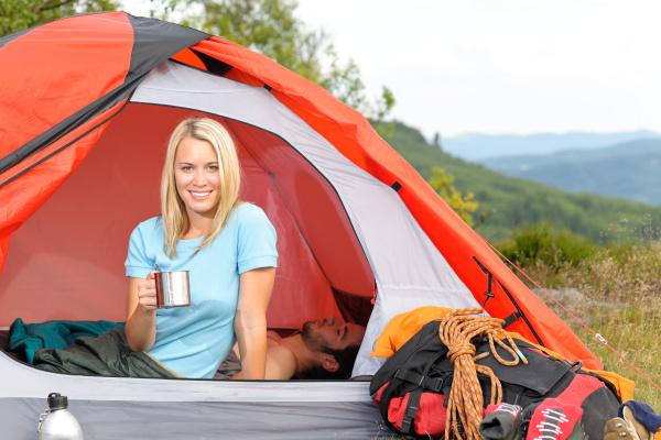 camping young woman drink mug sunset