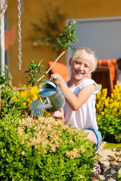 happy child pours flowers