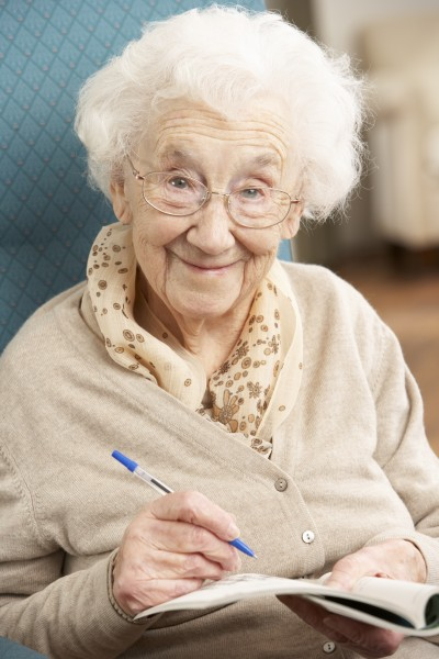 senior woman relaxing in chair at
