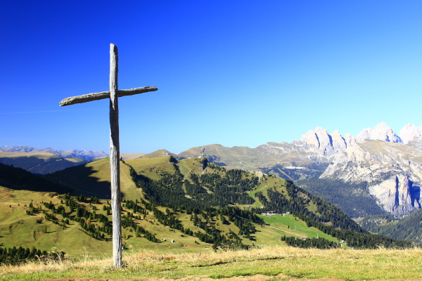 wooden cross in the dolomites at