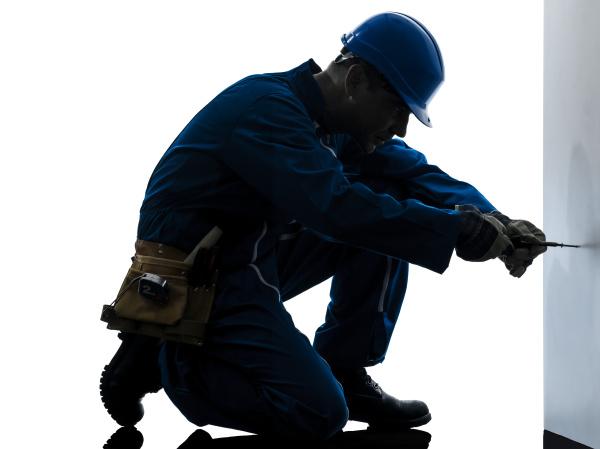 man construction worker screwdriving silhouette