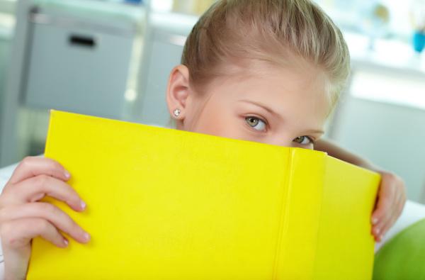 peeking out of book