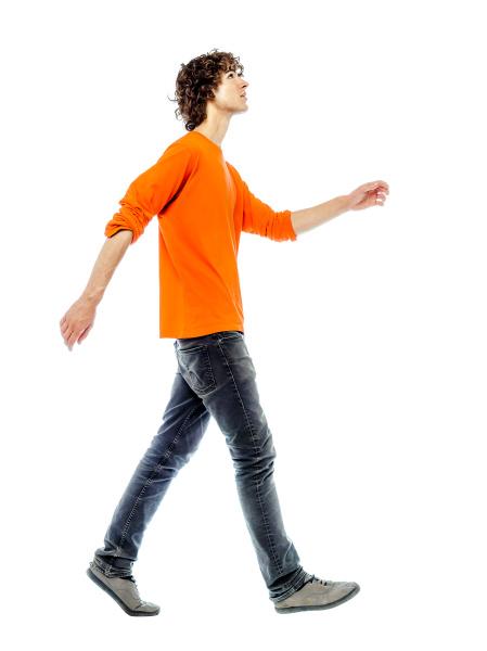 young man walking looking up