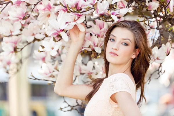 young laughing woman and magnolia portrait