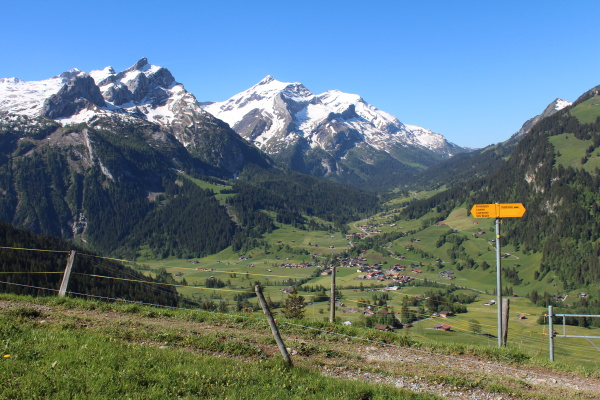 beautiful mountain landscape and directional sign