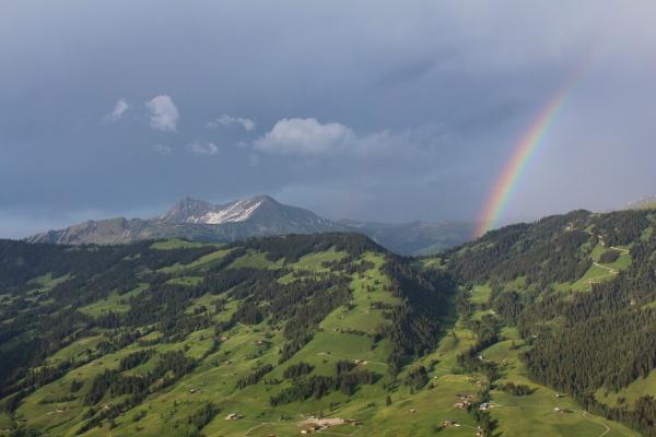 beautiful landscape and rainbow near gstaad