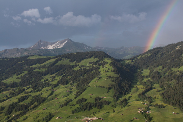 green hill and rainbow scenery in
