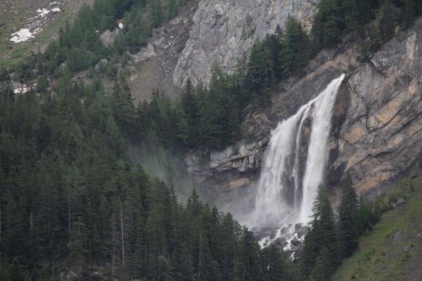 beautiful waterfall in gsteig bei gstaad