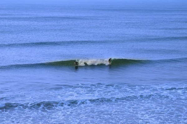 atlantic ocean with two surfers