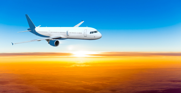 airplane, in, the, sky, at, sunset. - 10026466
