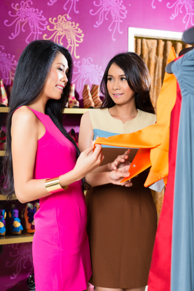 asian friends shopping in fashion store