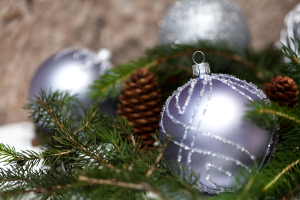 silver christmas tree balls in green