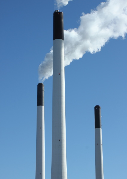 factory chimneys at energy plant with