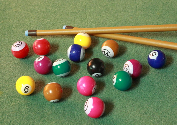 pool balls on green cloth in