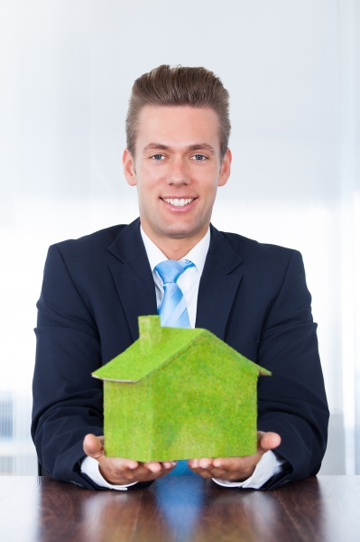businessman with eco friendly house