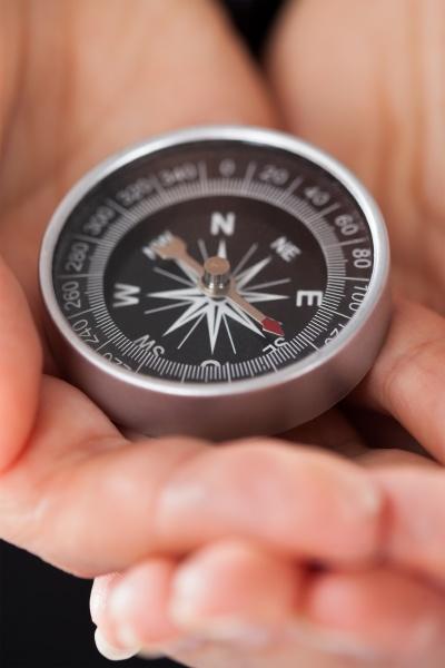 businessperson holding compass
