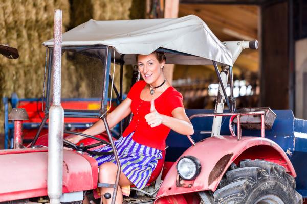 bavarian woman with dirndl rides trekker