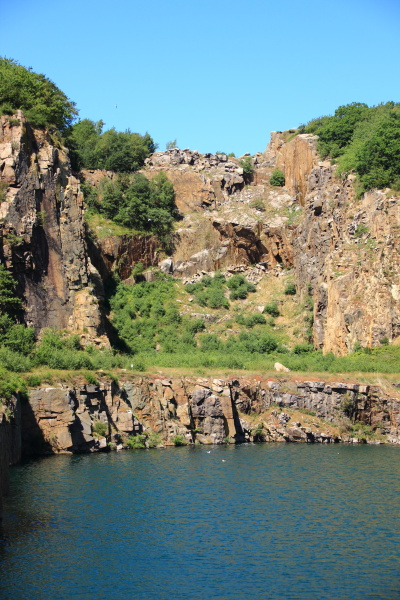 lake with cliffs and blue sky
