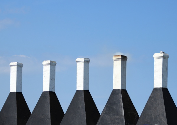 five chimneys on a smokehouse with
