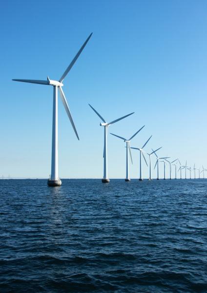 vertical perspective of ocean windmills with