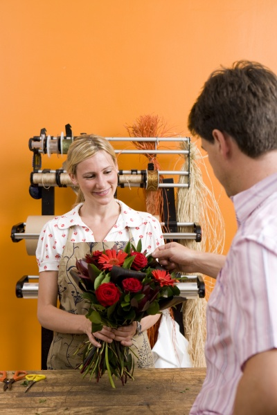 female florist with bouquet for customer