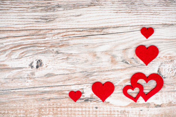 rustic wood background with bright red