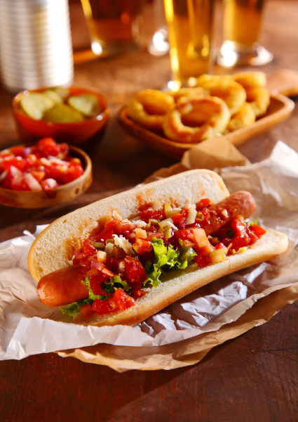 hot dog topped with fresh vegetable