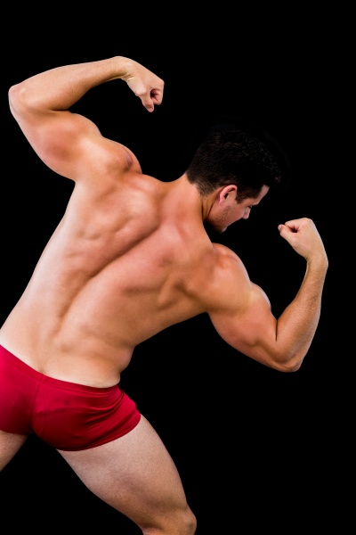 rear view of a shirtless muscular