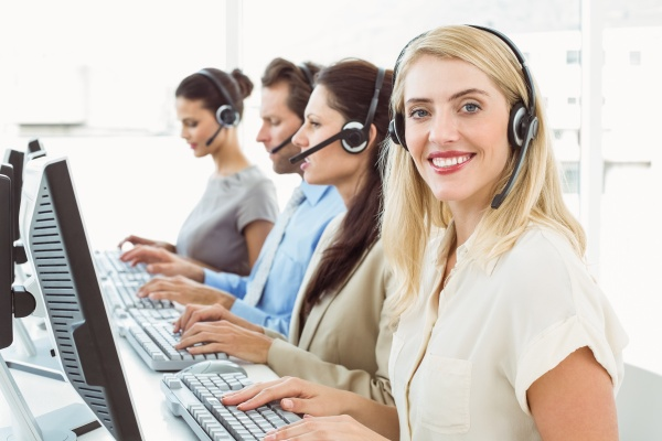 business people with headsets using computers