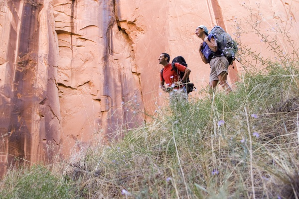 two hikers in a canyon in