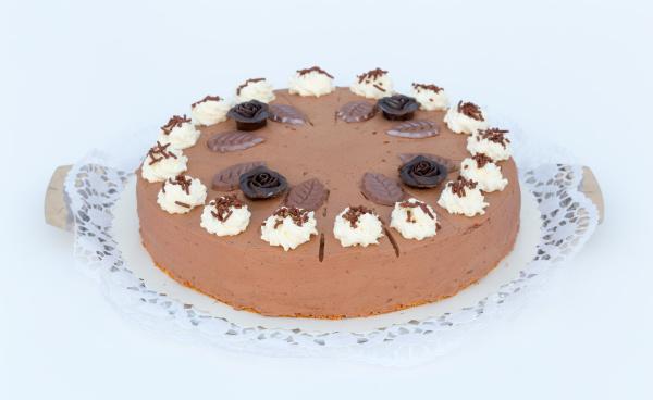chocolate cream cake on a white