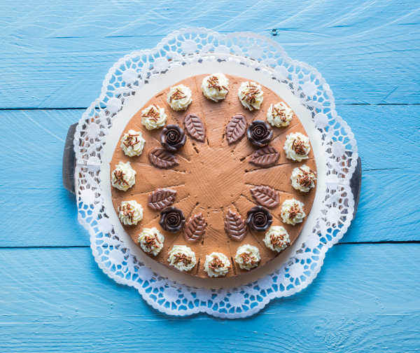 chocolate cream cake on blue wood