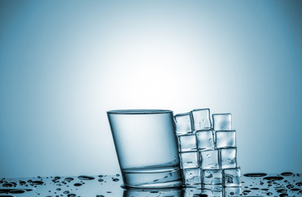 water in glass and ice cubes