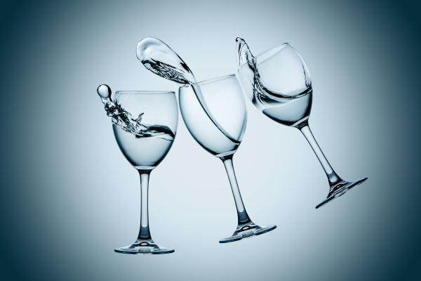three water glasses splash