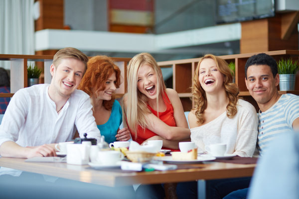 laughing in cafe