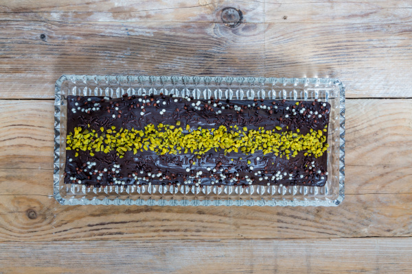 chocolate cake with pistachios on raw
