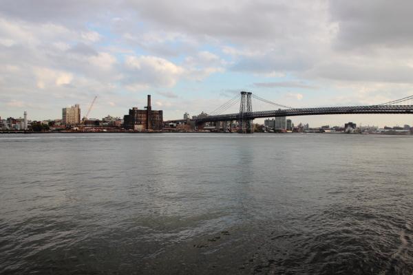 metal bridge crossing east river with